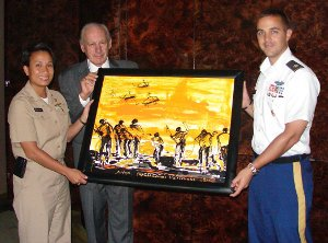 LCDR Kim Mitchell (left) and MAJ Ed Kennedy (right) accept a giclee of the painting