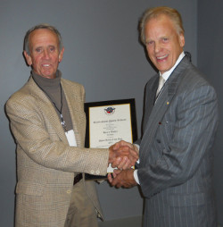 Harry Weber (left) receives the 2011 Sport Artist of the Year, Sculptor, Award from Trustee Jack Scharr