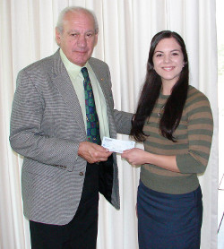Dr. Thomas P. Rosandich presents a $1,000.00 check to Sara Cole, Executive Secretary of the Academy and acting paymaster of the Marine Corps League of Daphne