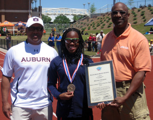 Auburn University sprinter Sheniqua Ferguson (middle) accepts the Academy's 2010 Athlete of the Year Award from Dr. Fred Cromartie, the Academy's Dean of Academic Affairs, (left) as head track and field coach Ralph Spry looks on. The award presentation occurred at the War Eagle Invitational on Saturday, April 16 at Auburn University.