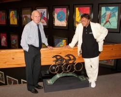 2000 Sport Artist of the Year Charles Billich and President and CEO Thomas P. Rosandich discuss painting a mural of a sports clock in the building's atrium during Billich's recent visit to the Academy.