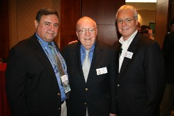 Michael Cleary (center), who is stepping down as National Association of Collegiate Directors of Athletics after 46 years, was honored by the United States Sports Academy on Thursday, June 16 at the NACDA annual convention in Orlando. Pictured with Cleary are Bob Vecchione (right), the new NACDA executive director, and Academy Vice President T.J. Rosandich (left).