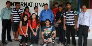 Academy Vice President and COO Dr. T.J. Rosandich (center) is pictured here with a group of Singapore students outside an International Sports Academy classroom.