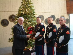 Dr. Thomas P. Rosandich and Marines during the 2010 Toys for Tots campaign