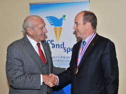 President and CEO Dr. Thomas P. Rosandich (left) and Prince Albert II of Monaco (right)