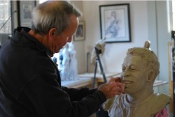 Harry Weber works on bronze bust of Pele