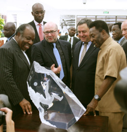 Gabon President Ali Bongo (left) presents a multi-dimensional acrylic sculpture honoring legendary soccer player Pelé (right).